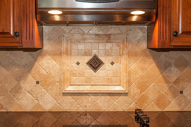 Traditional kitchen with stone backsplash and granite countertop