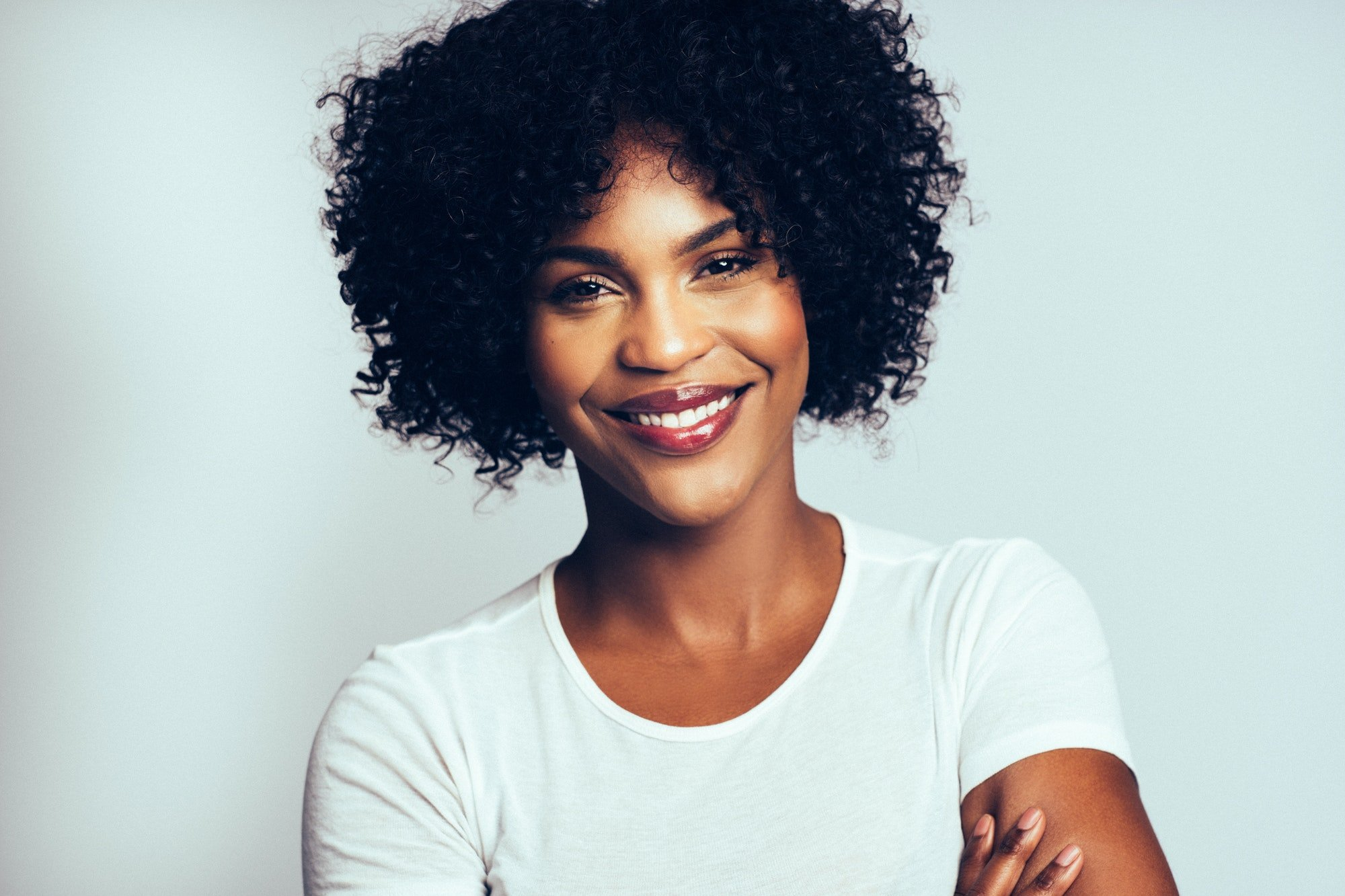 Profile of an attractive African woman against a gray background